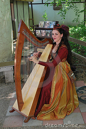 Harpist at Rennaissance Faire Editorial Stock Image