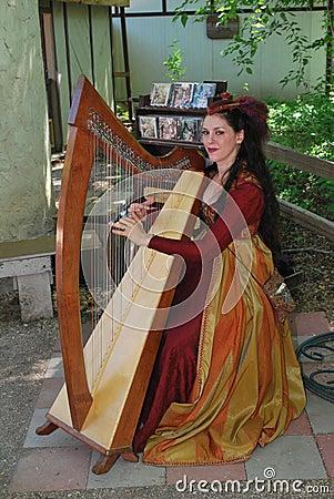 Harpist at Rennaissance Faire Editorial Stock Image