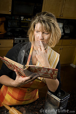 Harried woman with recipe book