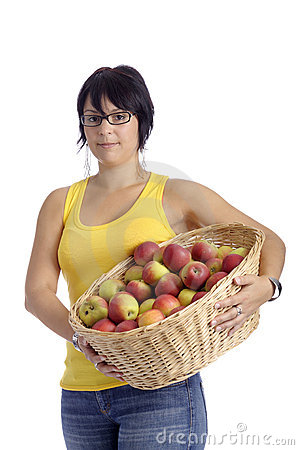 Harvest:young woman with basket full of apples