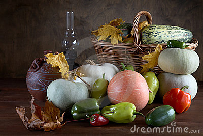 Harvested pumpkins with fall leaves on atable