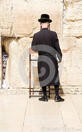 Hasidic Jewish man praying at The Western Wall Editorial Stock Photo