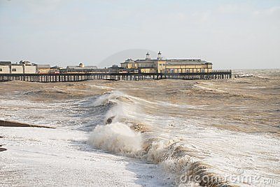 Hastings pier in stormy sea