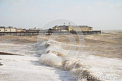 Hastings pier in stormy sea