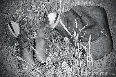 Hat and boots in the grass (BW)