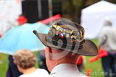 Hat with medals on head of man Editorial Photo