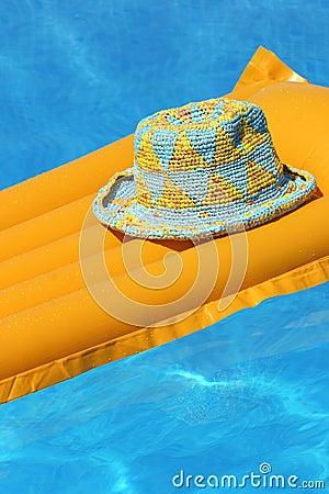 Hat on orange airbed