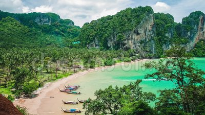 Hat Tom Sai Beach with long tail boats on the beach. Railay travel destination near Ao Nang, Krabi, Thailand.  stock footage