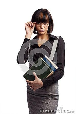 Haughty brunette schoolgirl hold books in the hand