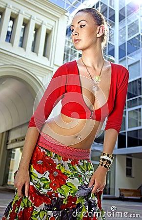 Haughty woman in motley skirt
