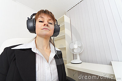 Haughty woman - producer with ear-phones