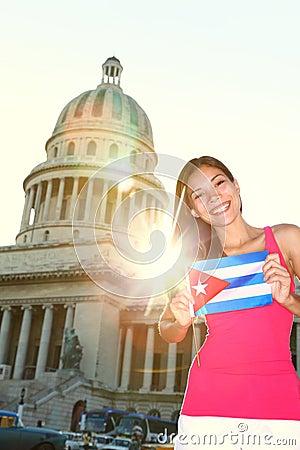 Havana, Cuba - Capitol and tourist with cuban flag