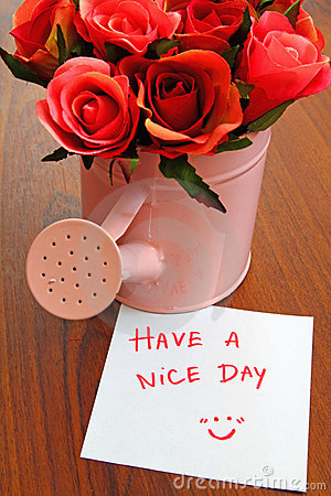 Have a nice day with roses in watering can