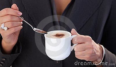 Having cappuccino