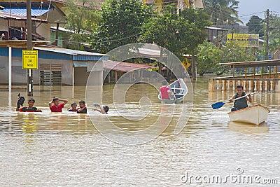 Having Fun in Flood Water Editorial Stock Image