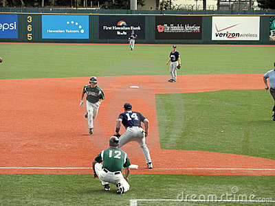 Hawaii Baseball player head to third base Editorial Stock Photo
