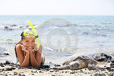 Hawaii girl swimming snorkeling with sea turtles