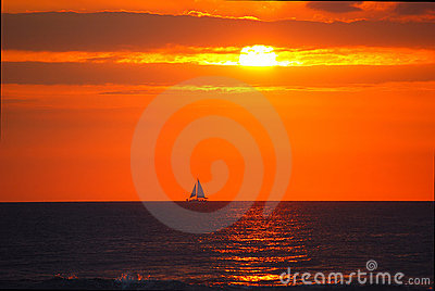 Hawaii sunset with sailboat