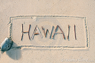 Hawaii written with sticks on the sand