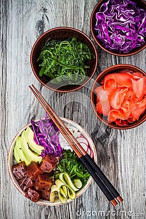 Free Hawaiian Tuna Poke Bowl With Seaweed, Avocado, Red Cabbage, Radishes And Black Sesame Seeds. Stock Image - 75011911