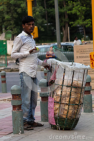 Free Hawker Is Waiting For Customer At Roadside Stock Photos - 98874303