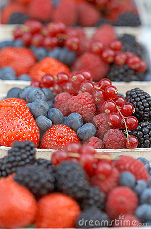 Hawker s stand with different berries.