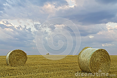 Hay bales and storm