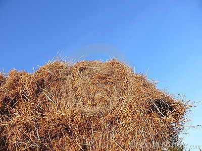 Haystack against blue sky