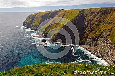 Haze and Sun on Remote Ocean Cliffs
