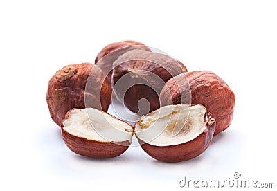 Split hazelnut on white