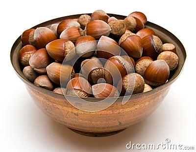 Hazelnuts in a copper bowl
