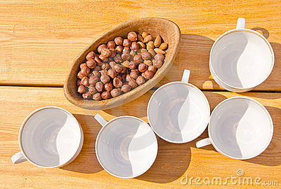 Hazelnuts pack in wooden dish cups placed on table