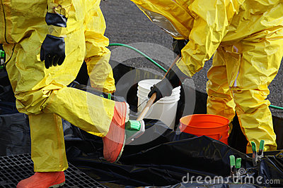 HAZMAT Team Members Clean Up Boots