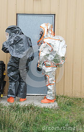 Hazmat team opening door