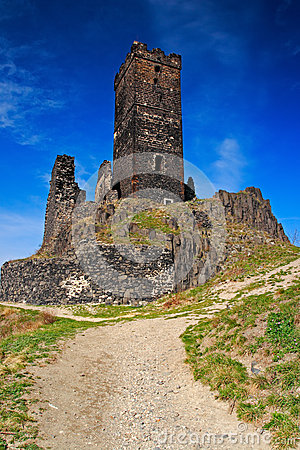 Free Hazmburk Gothic Castle On Rocky Mountain, With Gravel Path And Blue Sky, In Ceske Stredohori, Czech Republic. Stock Images - 67920654