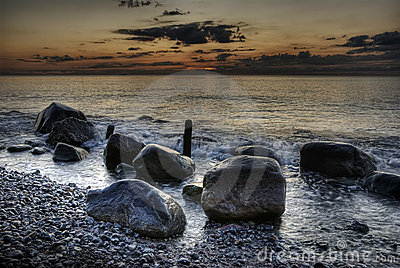 HDR stones in the ocean with sunrise