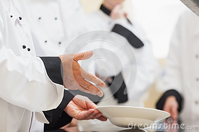 Head chef showing class a bowl