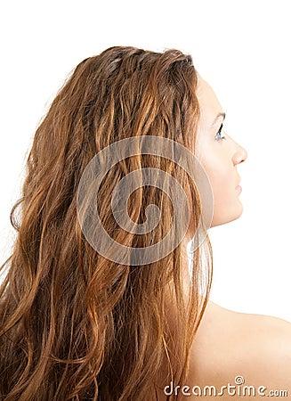 Head of long-haired girl over white