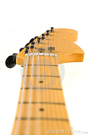 Head and neck of an electric guitar.