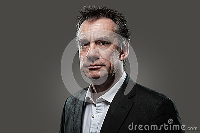 Head Shot of Business Man in Suit High Contrast