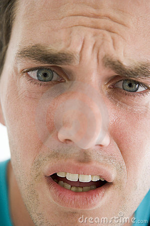 Head shot of man scowling