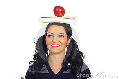 Head shot of student with book and apple