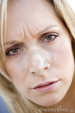 Head shot of woman scowling