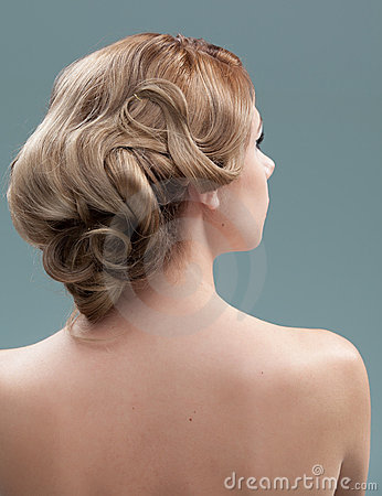 Head and shoulders back image of young woman hair