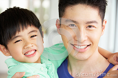 Head And Shoulders Of Chinese Father And Son