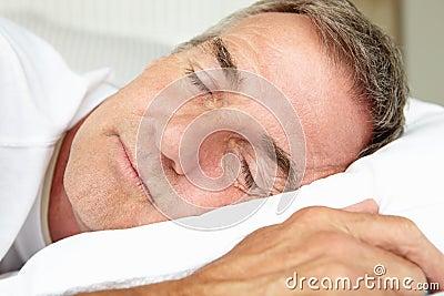 Head and shoulders mid age man sleeping