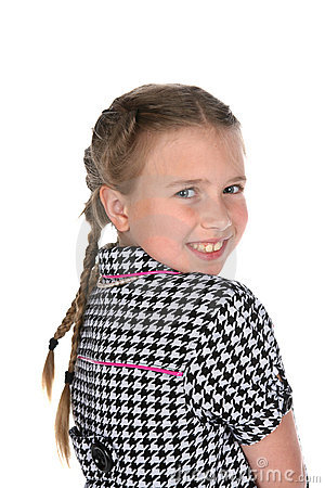 Head and shoulders portrait of cute girl in braids