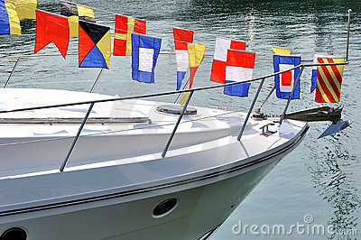 Head of yacht and colorful flag
