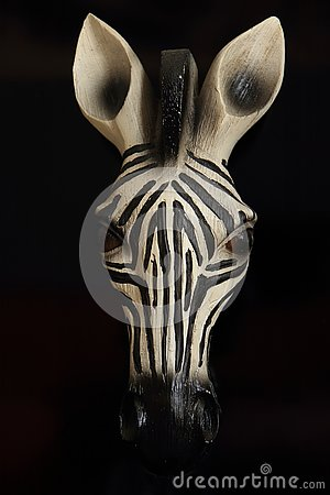 Wooden zebra head close up black background