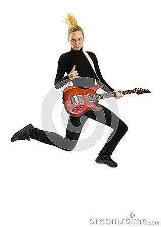 Headbanging woman guitarist jumps
